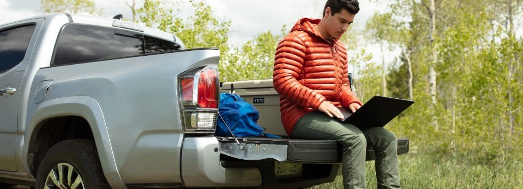 Person using laptop in bed of 2020 Tacoma