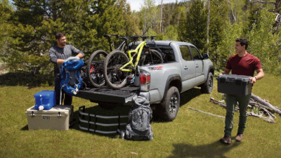 People unloading the bed of a 2020 Tacoma