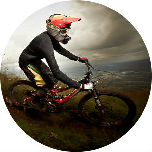 Man on Mountain Bike on Dirt Trail Wearing Helmet