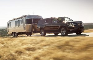 Chevy Suburban pulling a camper