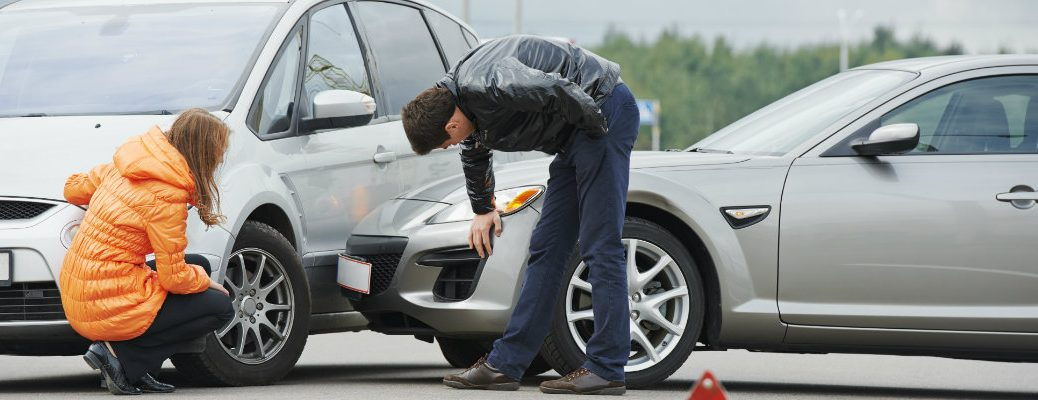 Drivers checking their vehicles after a collision