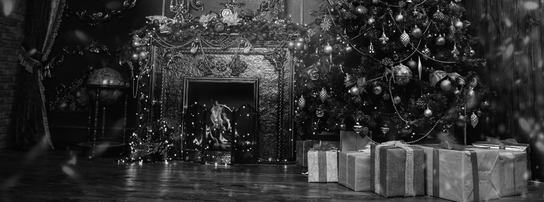 Black and white image of a home during the Christmas season