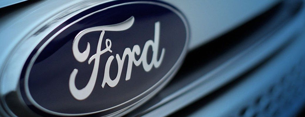 Close-up of Ford's blue oval logo on the front grille of a vehicle