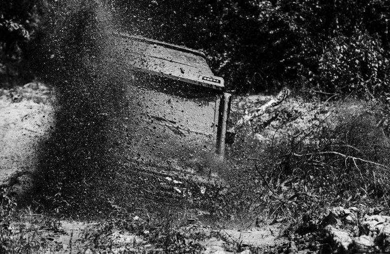 Vehicle dropping in to a mud and water pool
