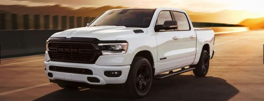 2021 RAM 1500 in white driving front view
