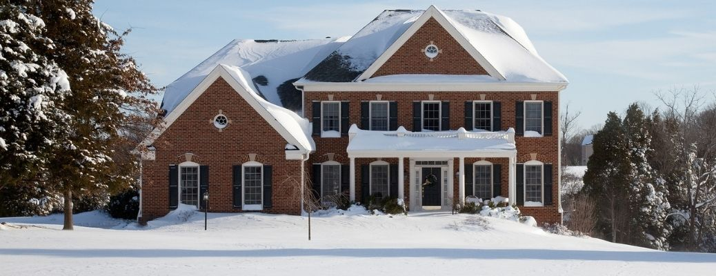 Home outside front view during winter