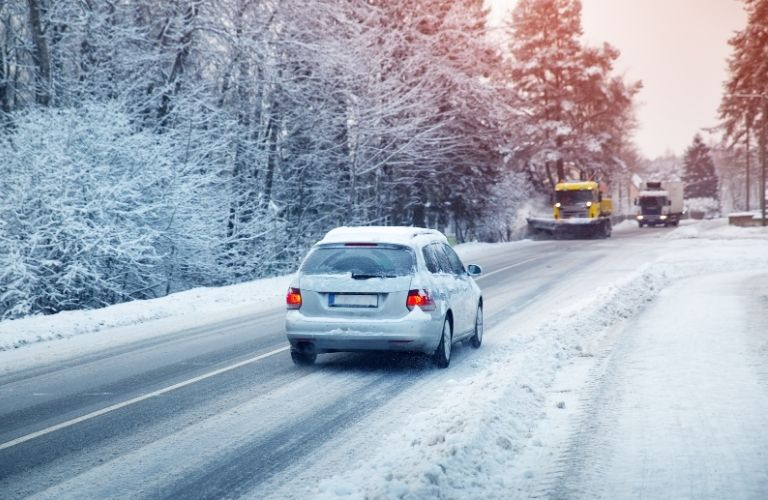 Car driving on the road in winter