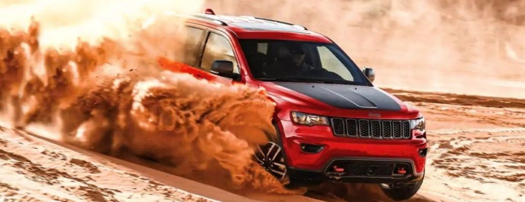 2021 Jeep Grand Cherokee driving on sand