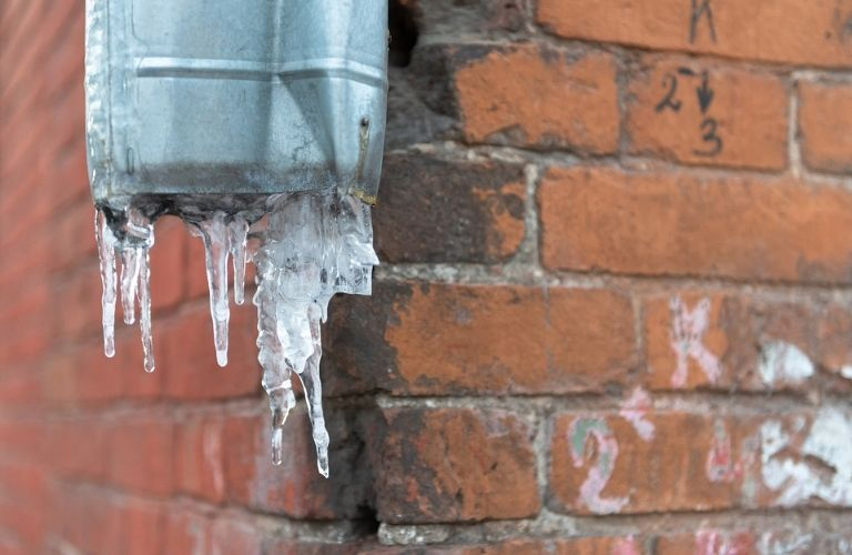 Water pipe with frozen ice
