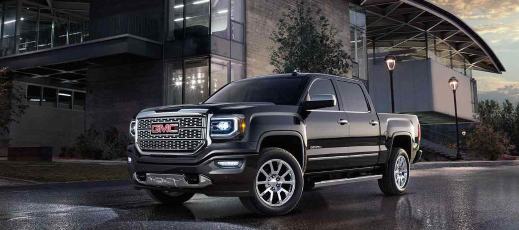 Black 2018 Gmc Sierra 1500 Denali Parked In Front Of A Warehouse