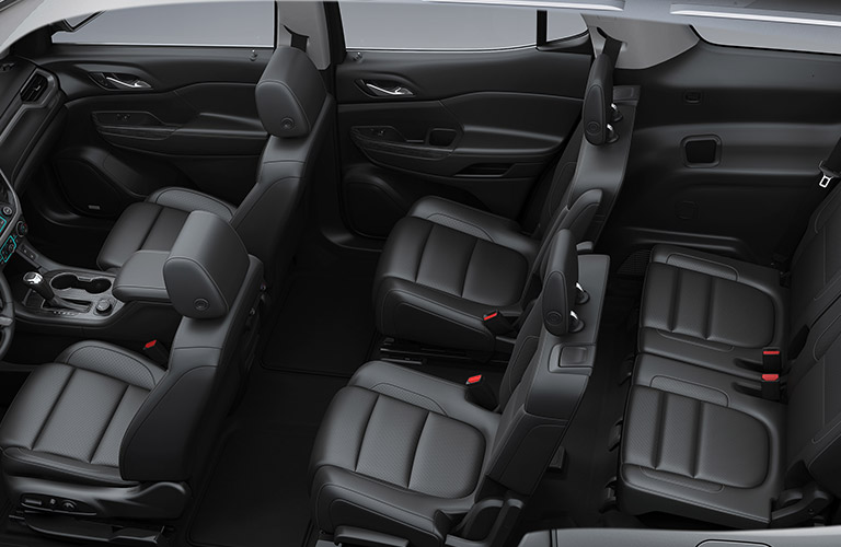 interior view of the three black rows of seating inside a 2019 gmc acadia