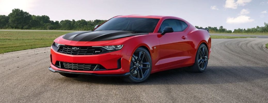 Exterior view of a red 2019 Chevrolet Camaro parked on an empty race track