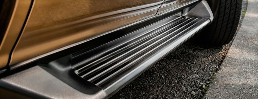 Closeup view of the running boards on a large SUV