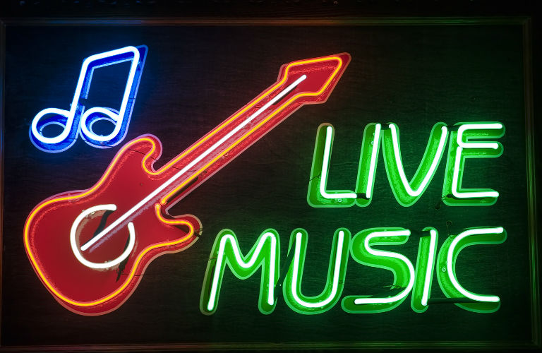 Live music spelled out in neon lights