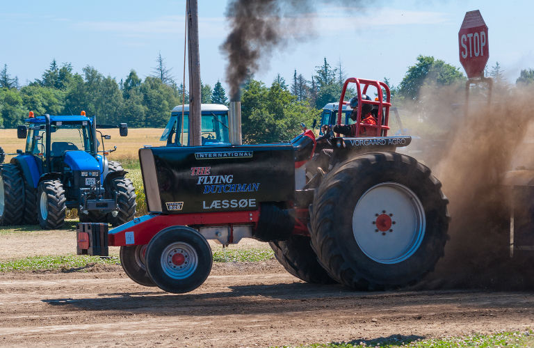 A tractor spinning it's tires