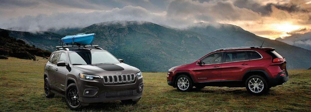 Two 2020 Jeep Cherokee crossover SUVs parked next to each other