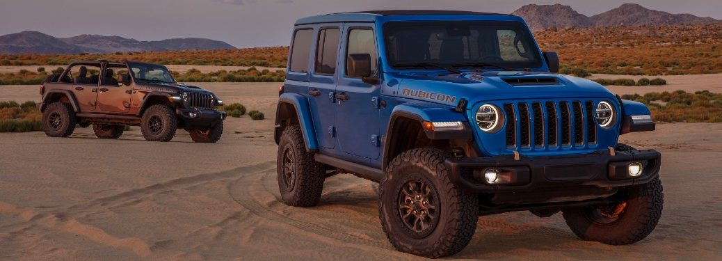 Two 2021 Jeep Wrangler Rubicon 392 SUVs parked by each other
