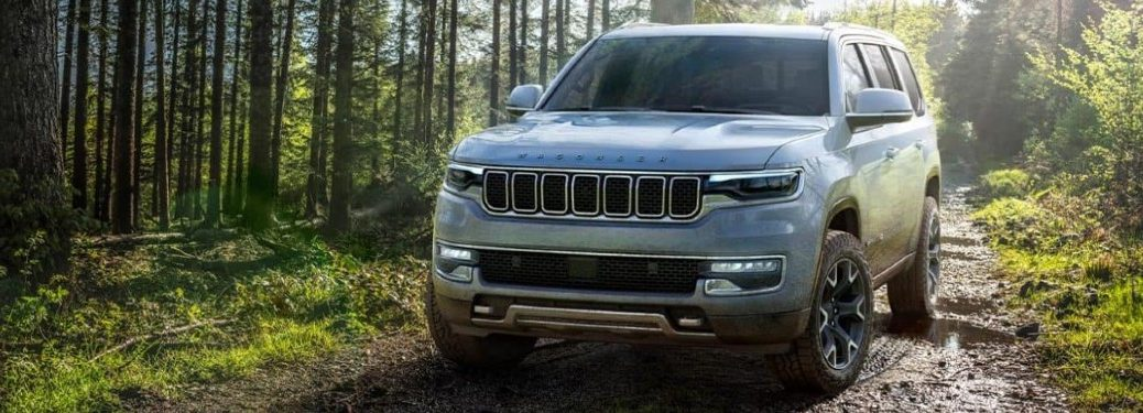 2022 Jeep Wagoneer driving on a muddy road