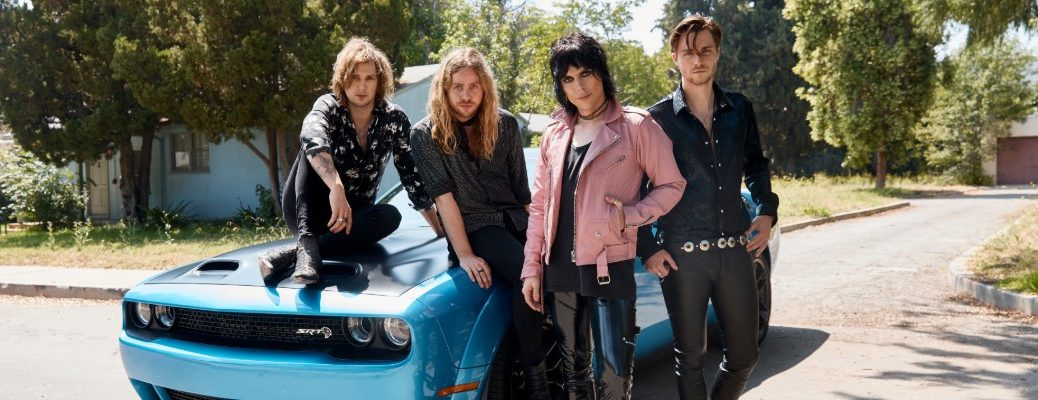The Struts band posing for a promotional image with the 2019 Dodge Challenger in sky blue paint coloring