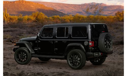 2020 Jeep Wrangler High Altitude exterior side shot with black paint color parked in a desert wilderness as the sun sets
