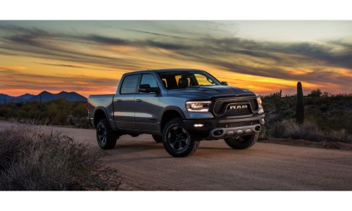 2019 Ram 1500 exterior shot on a desert country road at sunset