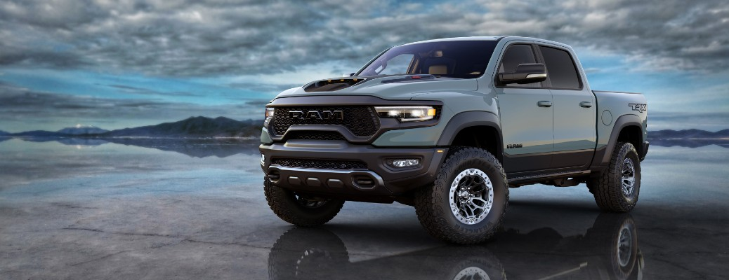 2021 Ram1500 TRX Launch Edition exterior shot with gray paint color parked on reflective ground with an overcast sky of clouds