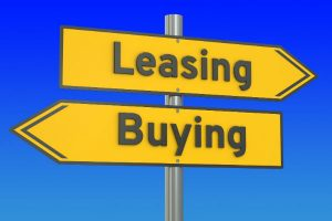 Sign with leasing pointed one way and buying pointed the other way