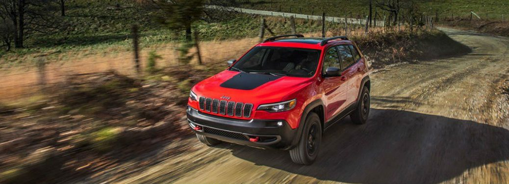 2019 Jeep Cherokee driving on a dirt road