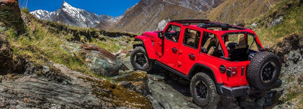 2020 Jeep Wrangler driving up a rocky hill