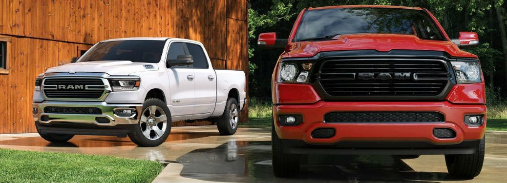 Two 2020 Ram 1500 trucks parked next to each other