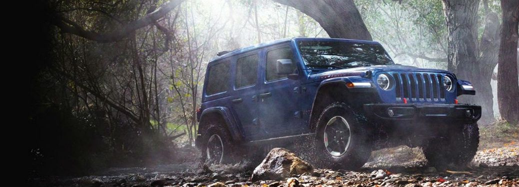 2020 Jeep Wrangler driving through the woods
