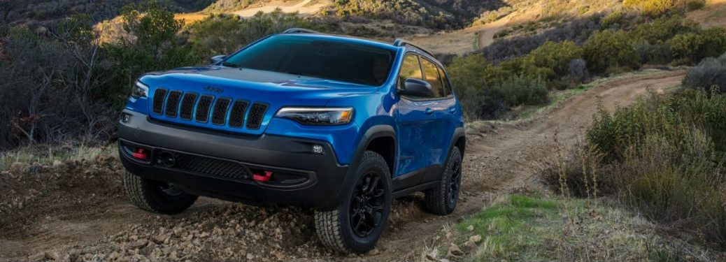2020 Jeep Cherokee driving up a hill