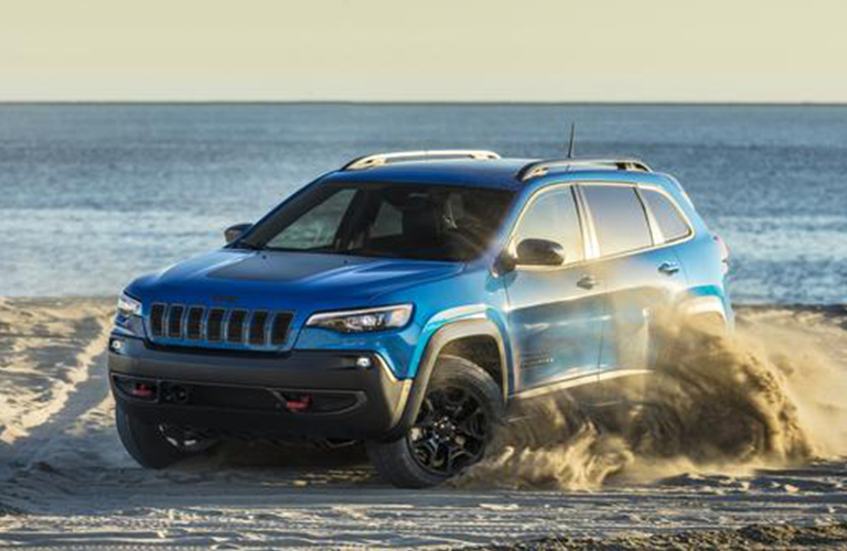 2020 Jeep Cherokee driving on a beach