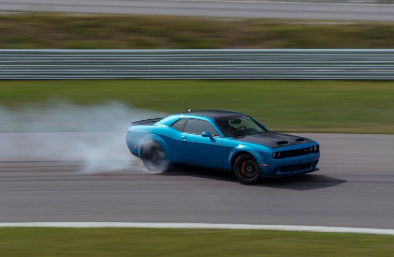 Dodge Challenger driving on a track