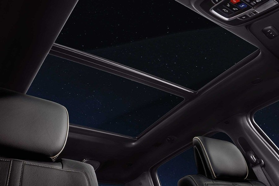 Passenger angle looking up at the open sunroof in the 2019 RAM 1500 at night