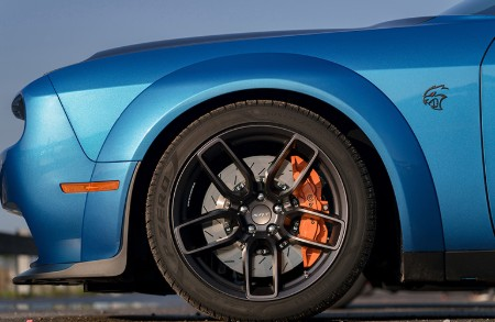 Close up of the front driver wheel on a blue 2019 Dodge Challenger SRT Hellcat