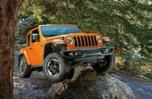 2019 Jeep Wrangler driving over a rock
