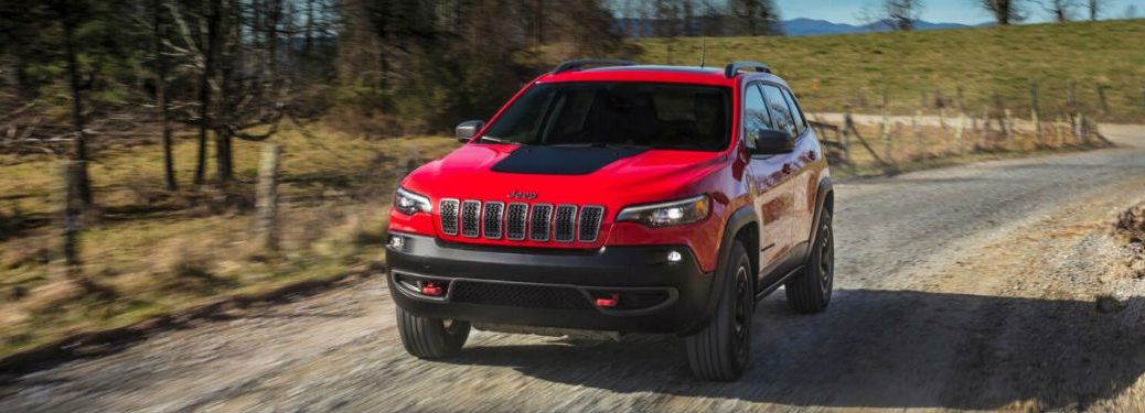 2020 Jeep Cherokee driving on a dirt road