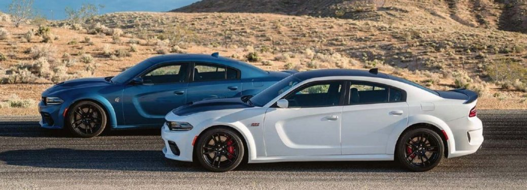 Two 2020 Dodge Charger sedans driving on a road