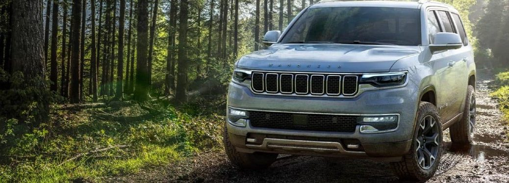 2022 Jeep Grand Wagoneer driving on a muddy off-road trail