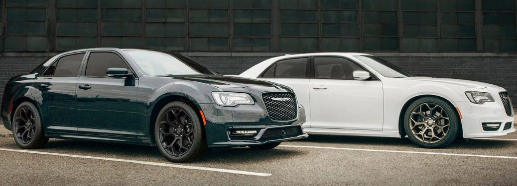 Front passenger view of a grey 2019 Chrysler 300 in front of a white 2019 Chrysler 300