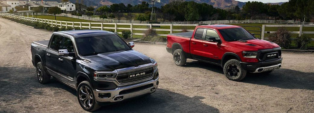 Two 2019 Ram 1500 trucks parked next to each other