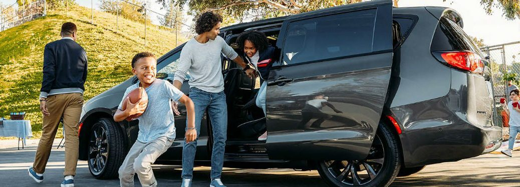 Children getting out of a 2020 Chrysler Pacifica