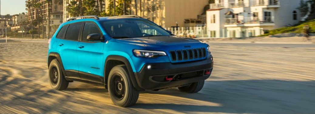 2020 Jeep Cherokee driving on sand