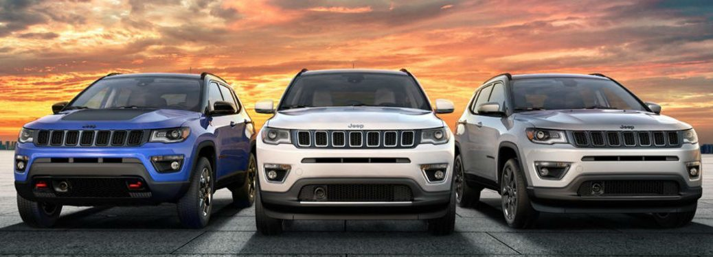 Three 2020 Jeep Compass crossover SUVs parked next to each other