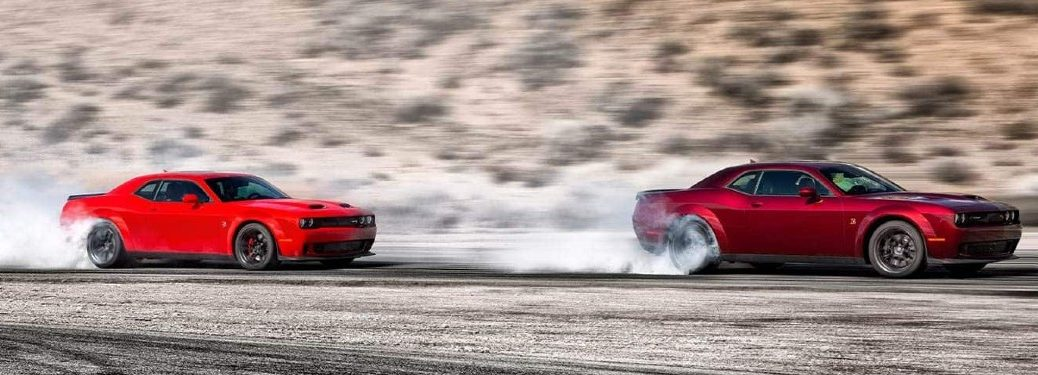 Two 2021 Dodge Challenger cars driving on road