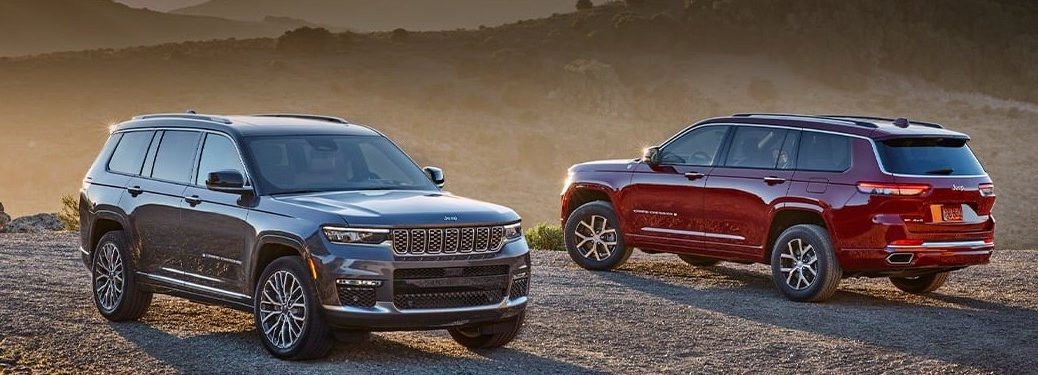 Two 2021 Jeep Grand Cherokee L SUVs parked next to each other