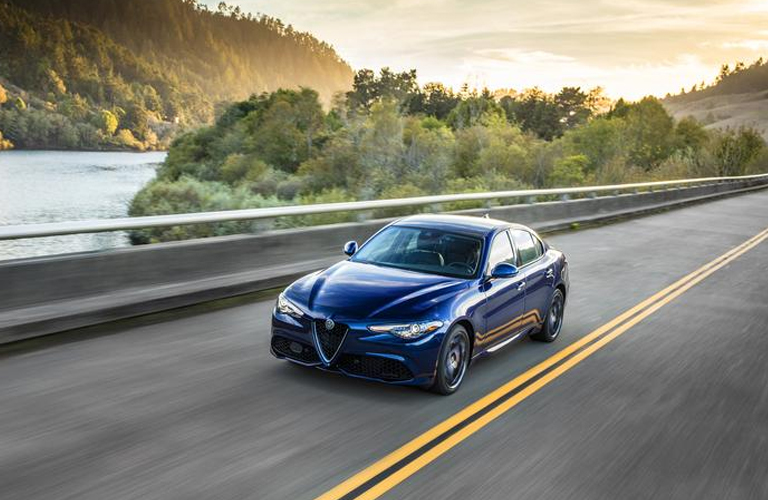 blue 2019 Alfa Romeo Giulia driving down the road