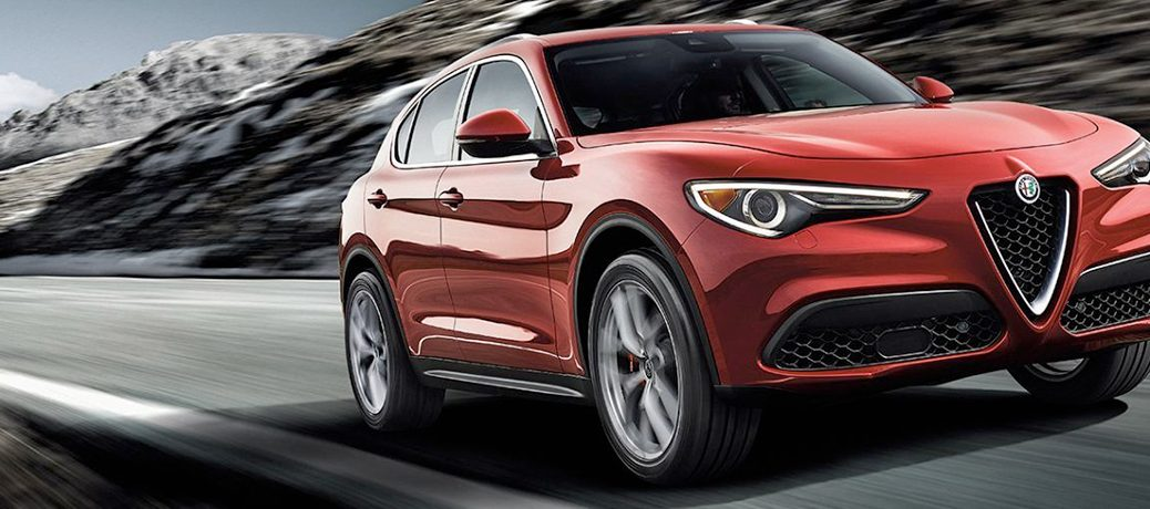 red 2019 Alfa Romeo Stelvio driving down road