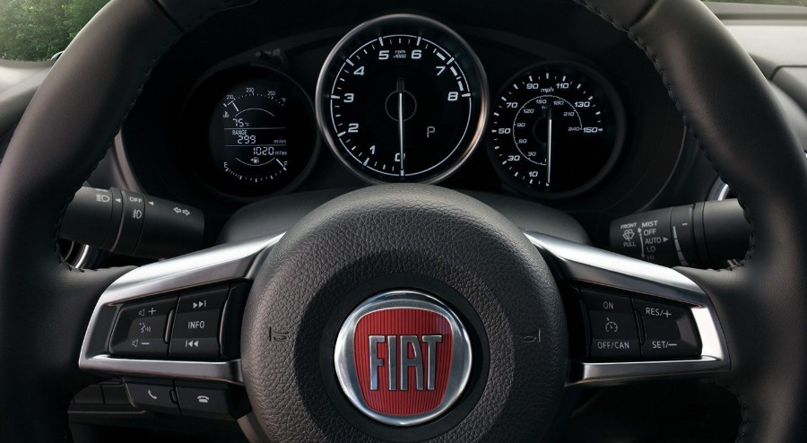 Close up of the steering wheel and dashboard inside the 2019 FIAT 124 Spider
